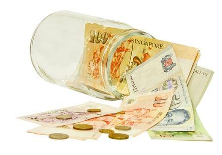 Singapore money in a jar photo