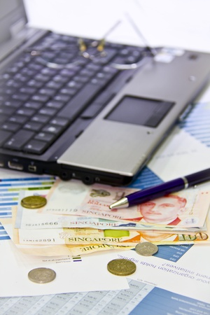 Singapore dollar money with laptop Stok Fotoğraf - 9294342