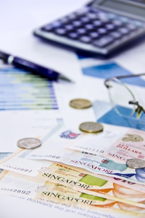Singapore dollar money with calculator