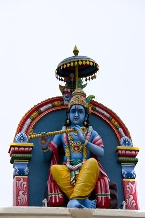 krishna: Krishna Standbeeld in het Sri Mariamman-tempel, Singapore Stockfoto