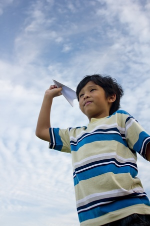 aspirational: An asian boy playing paper aeroplane, a concept of dream & ambition