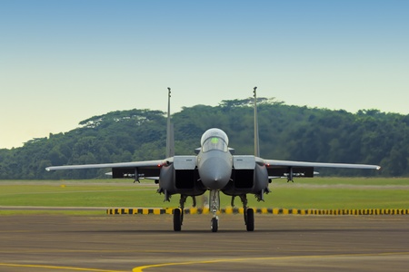 F15 Strike Eagle taxiing down on runway preparing to take-off