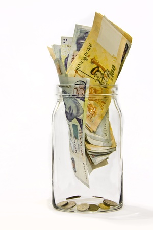 Singapore money in a jar, symbol of savings money, isolated in white background