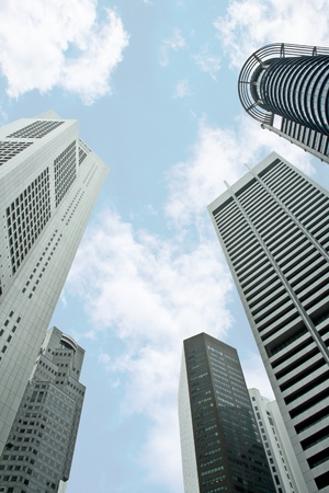 Singapore skyscrapers buildings taken from low angle with blue skies on the background