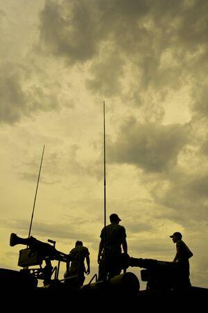 guerrilla warfare: Group of soldiers in defense line under the dark skies