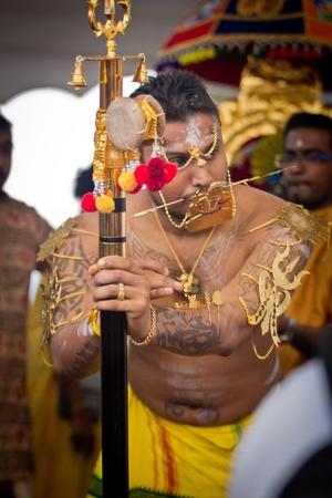 pierce: 7 February 2012: A Devotee in Thaipusam Festival with hooks pierce through his body Editorial