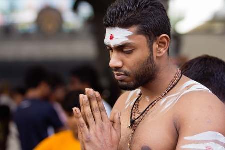 7 February 2012: A Devotee in Thaipusam Festival man is praying inside the temple before he starts his walk procession