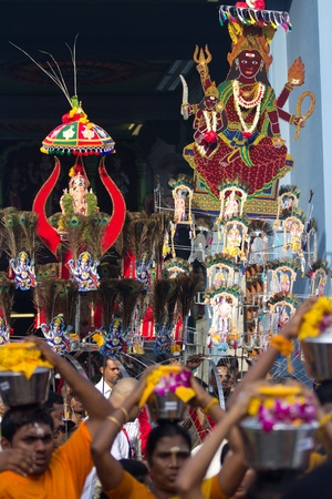 7 February 2012: A Devotee in Thaipusam Festival Kavadis walk in Thaipusam Festival procession