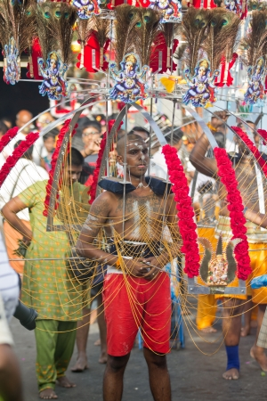 Little India - Singapore, 7 February 2012: A devotee in thaipusam festival starting his walk procession outside the temple Stock Photo - 13686232