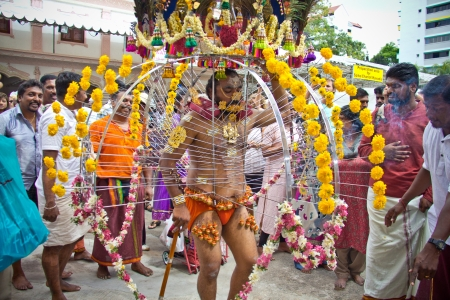 soulfulness: Little India - Singapore, 7 February 2012: A devotee in thaipusam festival starting his walk procession