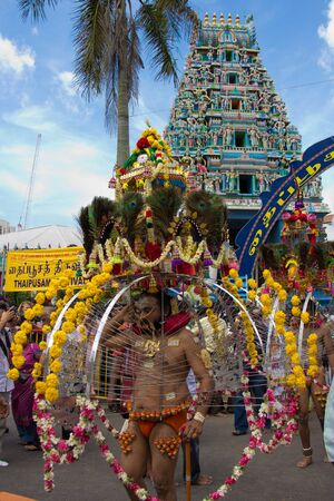 godliness: Little India - Singapore, 7 February 2012: A devotee in thaipusam festival starting his walk procession outside the temple