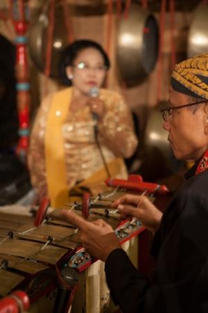 gamelan: Java Indonesia - 6-5-2012: a Javanese traditional musicians performing original GAMELAN ORCHESTRA