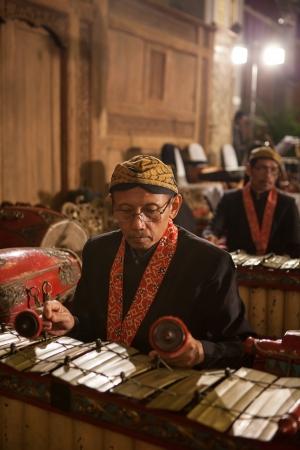 gamelan: Java Indonesia - 6-5-2012: a Javanese traditional musician performing original GAMELAN ORCHESTRA Editorial