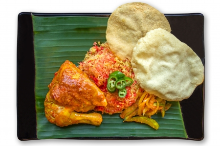 Indian traditional food, Briyani Rice served on banana leaf photo