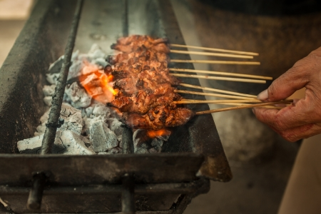 Satay being grilled on hawker food market