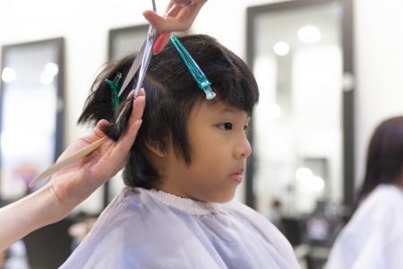 A young boy getting haircut in fancy hair salon Stok Fotoğraf - 17100346