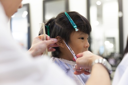 A young boy getting haircut in fancy hair salon photo