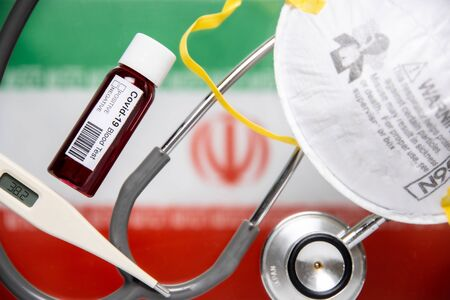 Concept of Coronavirus or Covid-19 pandemic to use as background with Iran Iranian country flag and medical blood test, stethoscope, surgical N95 mask, thermometer Stok Fotoğraf
