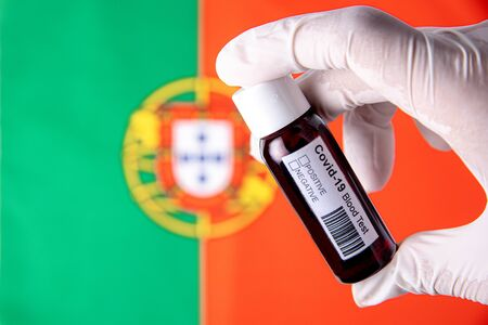 Concept of Coronavirus or Covid-19 pandemic to use as background with Portugal Portuguese country flag and medical blood test