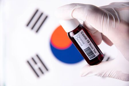 Concept of Coronavirus or Covid-19 pandemic to use as background with South Korea Korean country flag and medical blood test