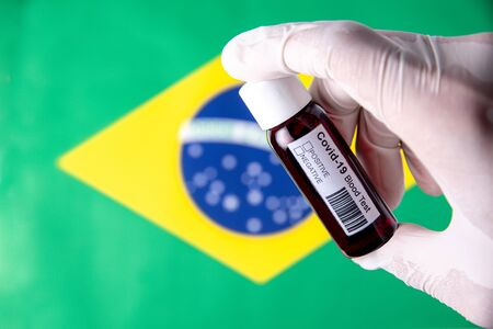 Concept of Coronavirus or Covid-19 pandemic to use as background with Brazil Brazilian Brasil country flag and medical blood test