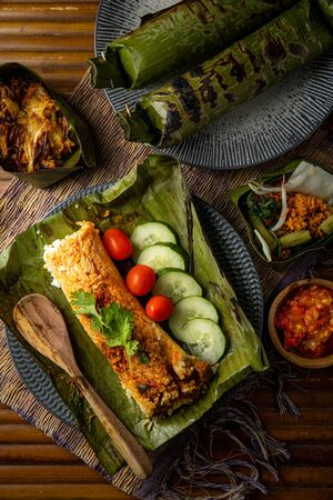 Nasi Bakar or Grilled Rice Toasted Rice  wrapped in Banana Leaf, Indonesian Traditional Food