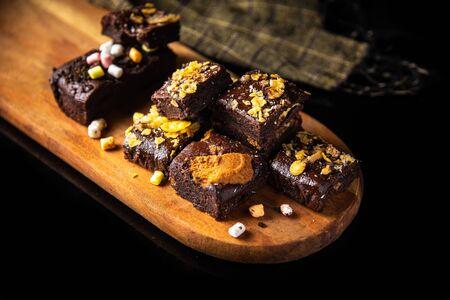 Homemade gluten free chocolate brownies as a sweet dessert in black background Stok Fotoğraf