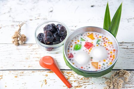 Asian Asia traditional desert bubur chacha or bobo chacha in Malaysia Singapore and Indonesia made of pumpkin, coconut milk, sago and pandan leaf with dates