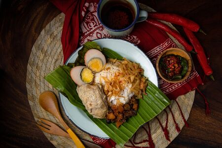 Asia Asian Culinary Traditional Food nasi liwet cooked in coconut milk, chicken broth and spices wrapped in banana leaf from Solo Central Java Javanese Indonesian
