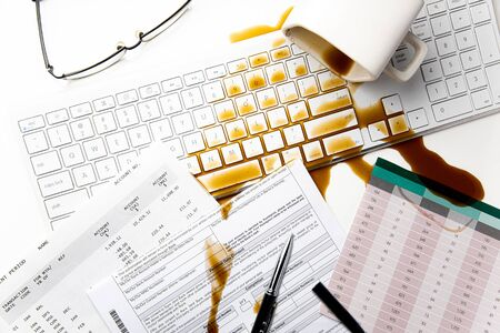 Cup of coffee spilled on office desk concept of careless clumsy or accident Stok Fotoğraf