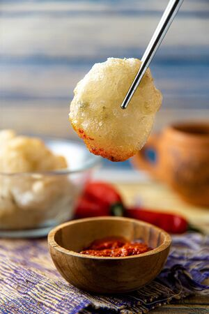 Cireng or aci goreng is a snack that comes from the West Java Sunda Bandung region in Indonesia, made by frying a mixture of dough made from starch or cimol cilok tapioca and onion