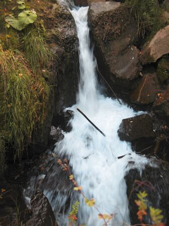 caucas: Honey waterfalls and autumn. The North Caucas. Stock Photo
