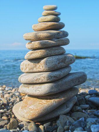 balanced rocks: Balanced stones on the seashore summertime and blue sky background Stock Photo