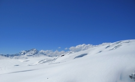 Caucasus mountains under the snow and clear sky Stock Photo - 11473916