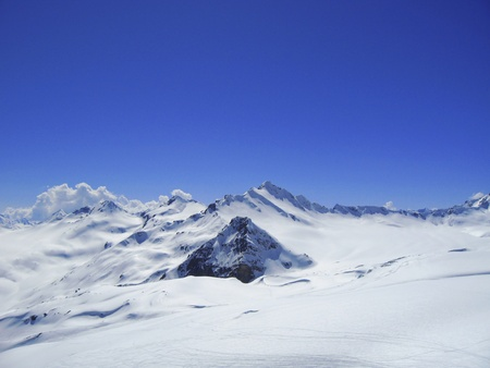 Caucasus mountains under the snow and clear sky Stock Photo - 11473919