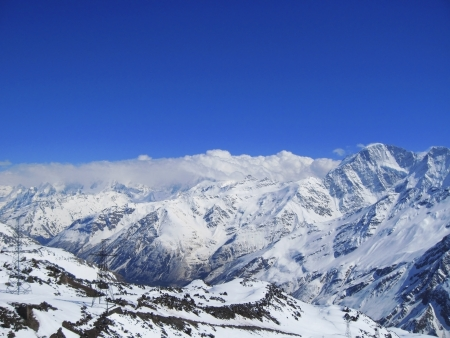 Caucasus mountains under the snow and clear sky Stock Photo - 11473925