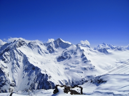 caucas: Caucasus mountains under the snow and clear sky