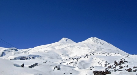 Caucasus mountains under the snow and clear sky. Elbrus photo