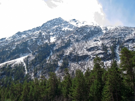 Caucasus mountains under the snow and cloudly sky Stock Photo - 11473904