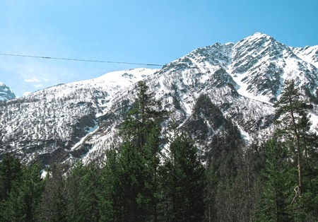 Caucasus mountains under the snow and clear sky photo