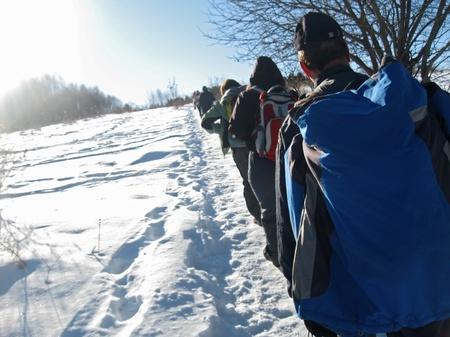 caucas: Team of tourists going for track. Winter Caucas