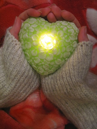 Valentine heart and heart shape candle in woman hands Stock Photo - 12195667