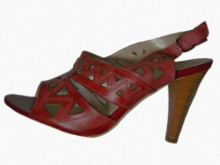 baclground: Brand new woman shoe with a high hill isolated on the white baclground