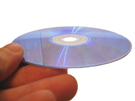 Compact disk and male finger isolated on the white background photo