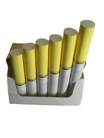Cigarette with a white filter isolated on the white background photo