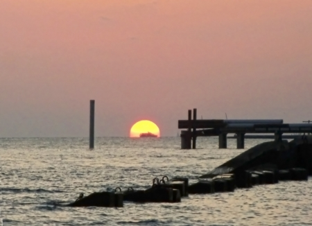 Round sun falling down over the Black sea photo