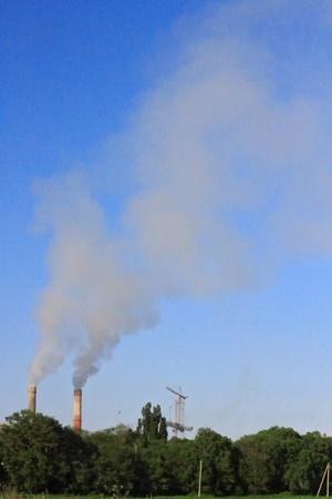 cement chimney: Smoke stacks of cement factory  Summertime landscape
