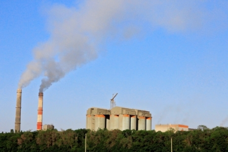 Smoke stacks of cement factory  Summertime landscape