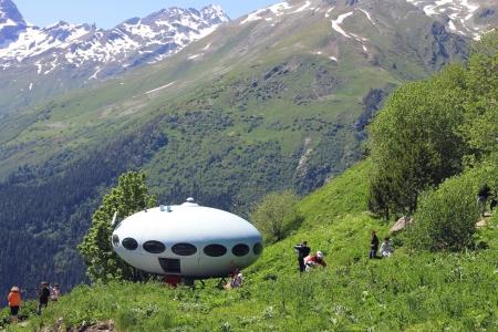 People around UFO the landing between caucasus mountains