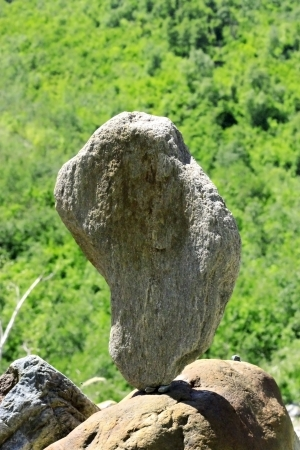 Balanced stones near the caucasus mountain river photo
